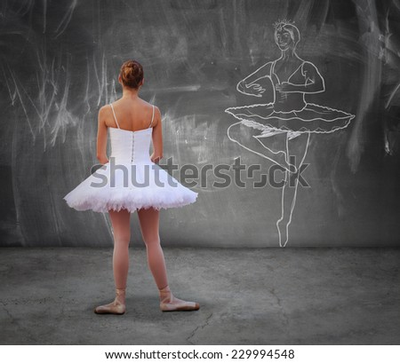 Young dancer girl looking a draft of classic dancer on the wall, aspiring to be like her - stock photo