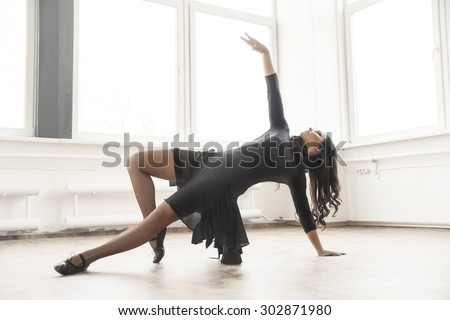 young dancer having rehearsal in studio - stock photo