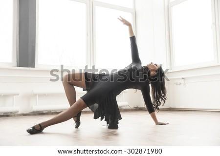 young dancer having rehearsal in studio - stock photo