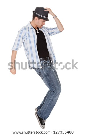 Young dancer touching his hat and one arm outstretched - stock photo