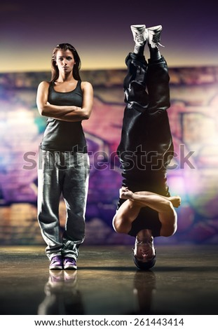 Young dancers couple on urban background at night. - stock photo