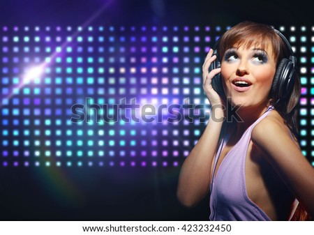 young dancing girl in headphones  - stock photo