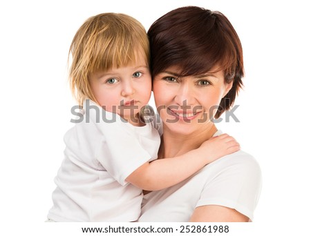 young dark-haired woman holding a little blond baby on hands on a white background - stock photo