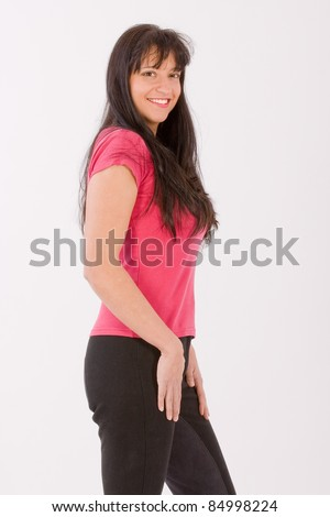 Young dark-haired woman in a fashionable riding clothes /Fashion for horseback - stock photo
