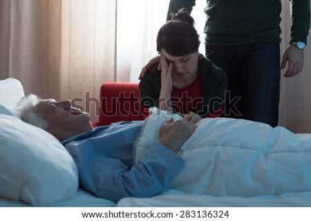Young daughter depressed after her father's death in hospital - stock photo