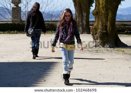young daughter leaving her mother behind