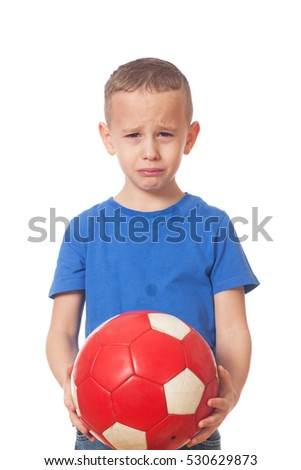 Young defeated soccer player on isolated white