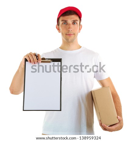 Young delivery man holding parcel and clipboard, isolated on white - stock photo