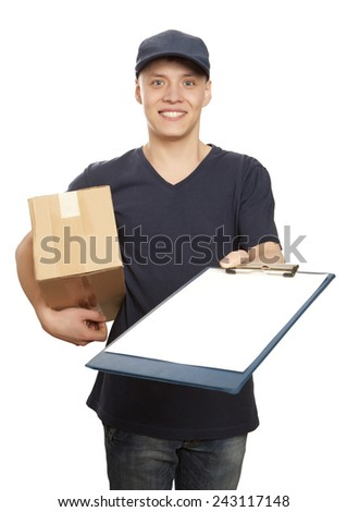 Young delivery man with boxes giving you a document to sign - stock photo