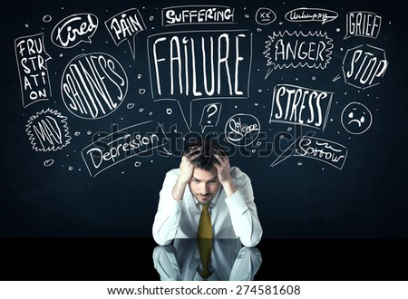 Young depressed businessman sitting under white drawn trouble thought boxes - stock photo