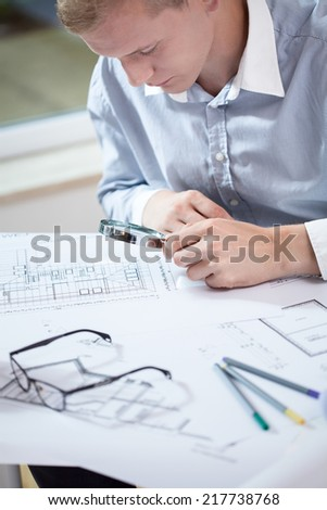 Young designer checking the new project in his office