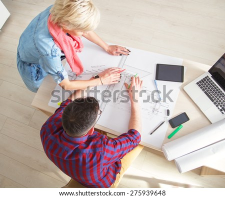 Young designers working on new project in office. - stock photo