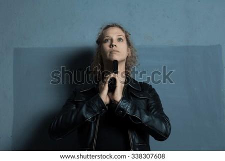 Young despair woman with handgun killing herself - stock photo