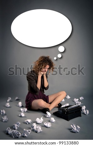 Young desperate girl writing with an old typewriter. Conceptual image with balloon. - stock photo
