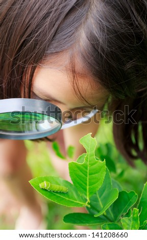 young detective,little girl in garden - stock photo