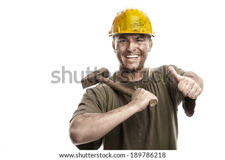 Young dirty smiling Worker Man With Hard Hat helmet  holding a hammer isolated on White Background