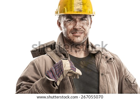 Young dirty Worker Man With Hard Hat helmet  holding a hammer and smiling isolated on White Background