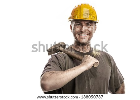 Young dirty Worker Man With Hard Hat helmet  holding a hammer isolated on White Background