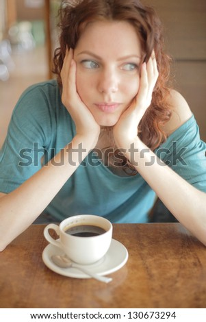 Young disappointed woman looking away - stock photo