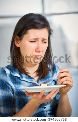 Young disgust female after trying piece of cake, healthy diet concept, avoid sugar - stock photo