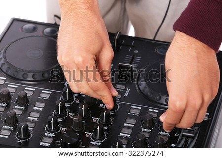 young disk jockey hands mixing on sound mixer - stock photo