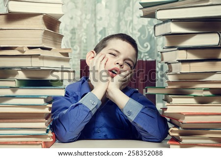 Young distressed student sleeping on the desk. - stock photo