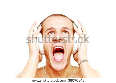 Young DJ with tattoos on arms screaming while his music pushes him... - stock photo