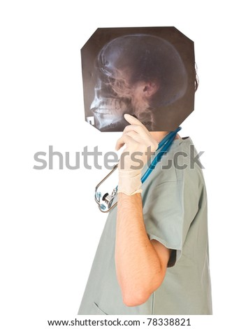 Young doctor hiding his head behind skull x-ray - stock photo