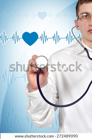 Young doctor holding stethoscope on blue background - stock photo