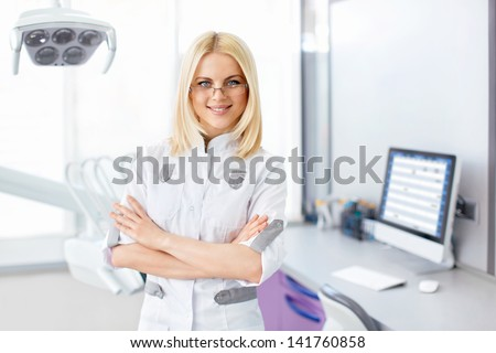 Young doctor in a dental clinic - stock photo