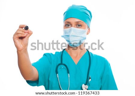 Young doctor is drawing, isolated on white background