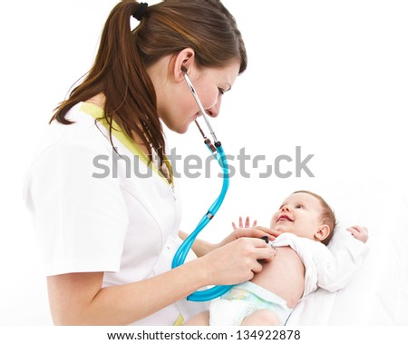 young doctor is examinating a little baby with a stethoscope - stock photo