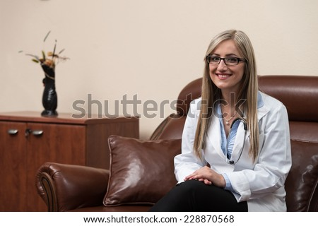Young Doctor Relaxes Sitting In The Office - stock photo