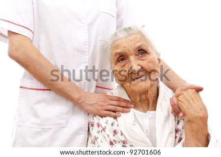 young doctor's hand on an old woman patient's shoulder - stock photo