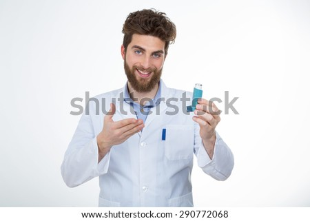 young doctor showing a drug to his patient