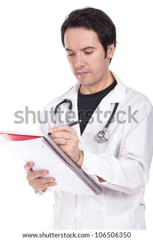 young doctor standing and writing a prescription - stock photo