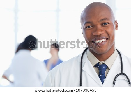 Young doctor standing with his stethoscope around his neck