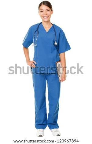 Young doctor. Studio shot over white of a young Asian female doctor, wearing blue scrubs and with a stethoscope draped around her neck - stock photo