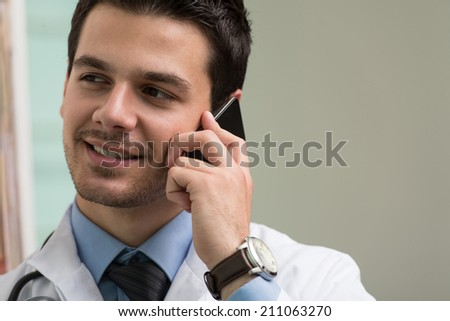 Young Doctor Talking On The Phone