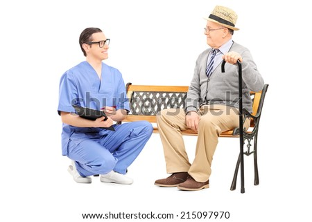Young doctor talking to a senior gentleman isolated on white background - stock photo