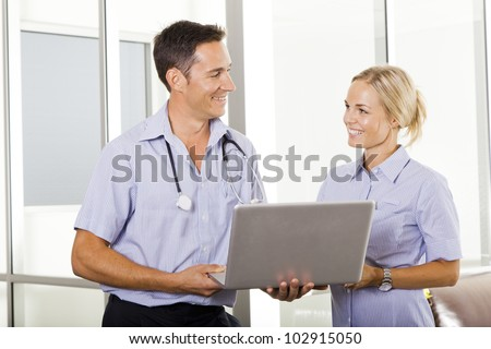 Young doctor talking with attractive nurse