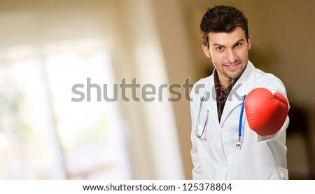 Young Doctor Wearing Boxing Gloves Giving Invitation, Indoor
