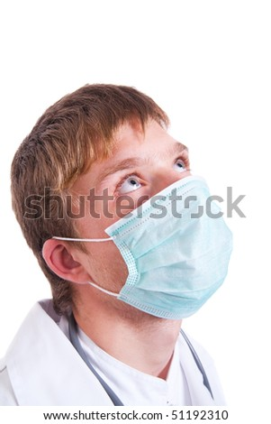 Young doctor wearing surgical mask.