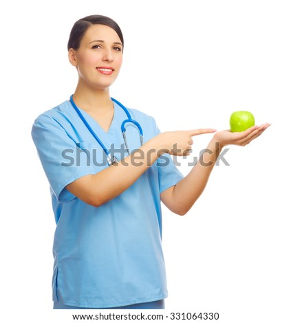 Young doctor with green apple isolated - stock photo
