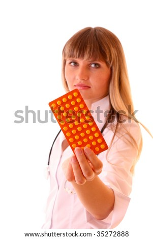Young doctor with tablets isolated on white