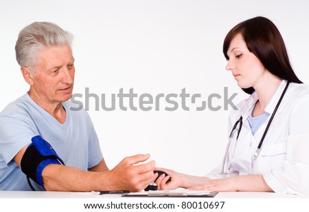 young doctor with the patient on a white