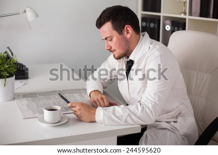 young doctor working with computer in office - stock photo