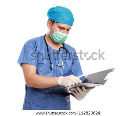 Young doctor writing