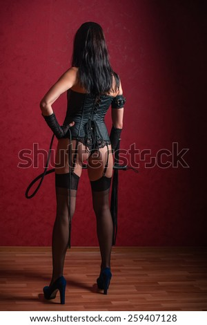 Young Domina view from Back - stock photo