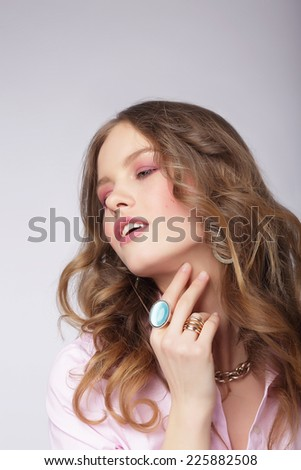 Young Dreamy Cutie with Precious Shining Ring - stock photo